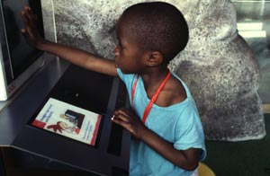 child and a computer africa